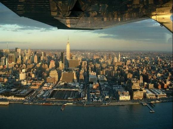 ny Under the wing of the plane